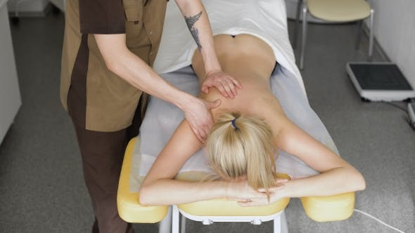 Thumbnail for Physiotherapist Doing Neck Massage To His Patient In Medical Office