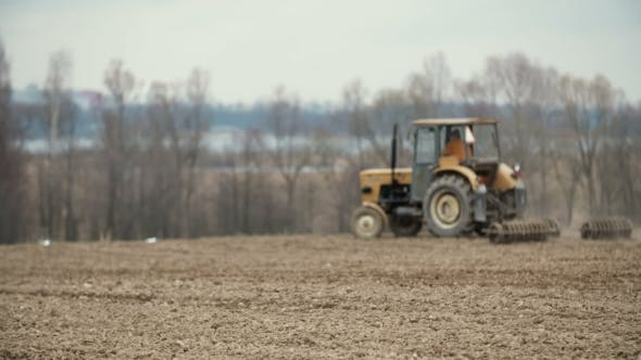 Cover Image for Agricultural Tractor Sowing And Cultivating Field