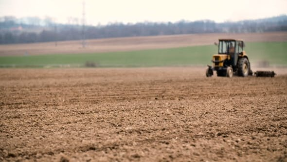 Thumbnail for Agricultural Tractor Sowing And Cultivating Field