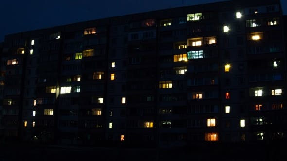 Cover Image for Multistorey Building With Changing Window Lighting At Night.