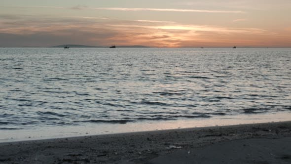 Thumbnail for Sunset Light and Gentle Waves Along the Coast