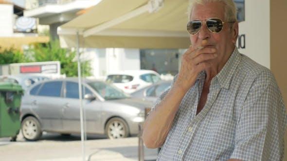 Thumbnail for Smoking Senior Man In The Street