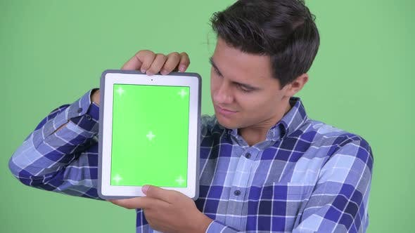 Cover Image for Face of Happy Young Handsome Hipster Man Showing Digital Tablet