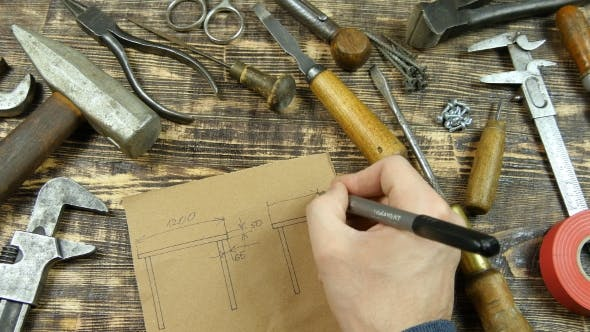 Thumbnail for Man Draws a Draft. Indicates Dimensions. Vintage Tools On Background