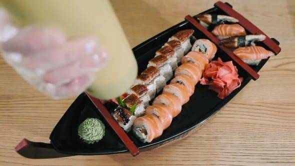 Thumbnail for Sushi Master Pouring Sushi Rolls With Unagi Sauce