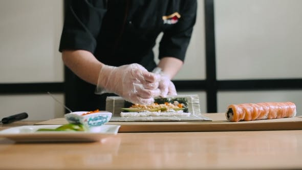 Thumbnail for Sushi Chef Preparing Rolls Using a Bamboo Mat