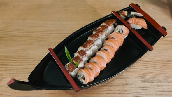 Sushi Master Puts Sushi And Wasabi On a Plate