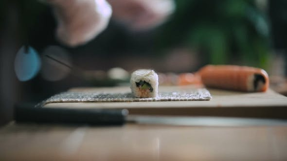 Thumbnail for Male Hands Cooking Sushi Rolls