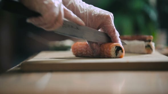 Cutting Sushi Roll Into Portions