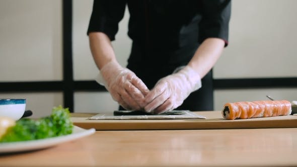 Sushi Master Spreads Rice On Nori
