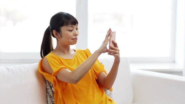 Thumbnail for Happy Asian Woman Taking Selfie With Smartphone
