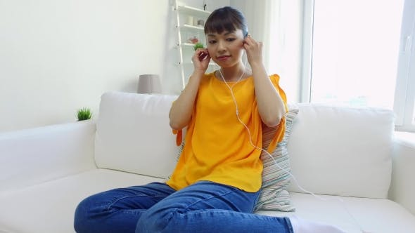 Thumbnail for Happy Asian Woman With Smartphone And Earphones