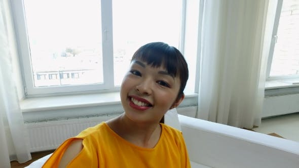Thumbnail for Happy Asian Young Woman Taking Selfie