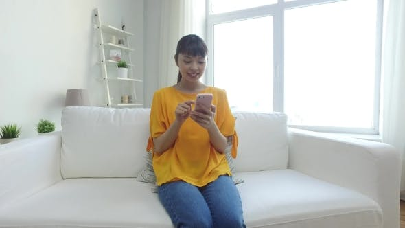 Thumbnail for Happy Asian Woman With Smartphone At Home