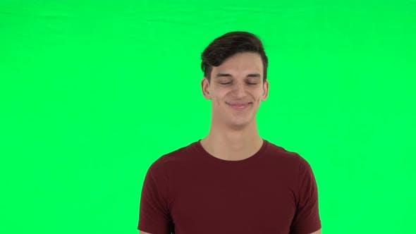 Thumbnail for Guy Smiling While Looking at Camera. Green Screen