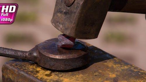 Blacksmiths Work with Hammers