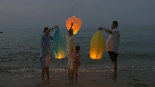 Thumbnail for Family Flying Sky Lantern On The Beach