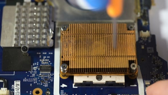 Thumbnail for Man Repair Laptop Motherboard With Screwdriver