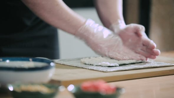 Thumbnail for Sushi Chef Preparing Rice For Sushi Roll
