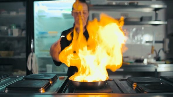 Thumbnail for Chef Doing Flambe With Sausage