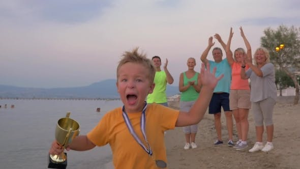 Cover Image for Happy Little Winner Running With Trophy