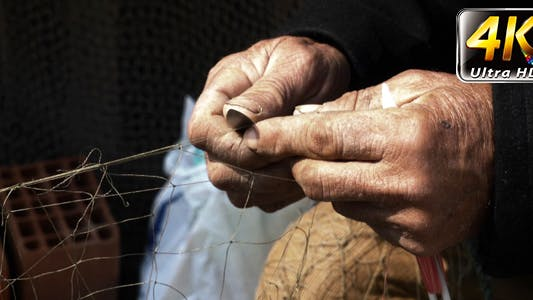 Thumbnail for Fisherman Repairs Fishnets Fishing Lines 2