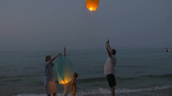 Thumbnail for Happy Family Releasing Sky Lantern