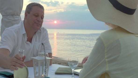 Thumbnail for Mature Couple Enjoying Evening On The Seashore