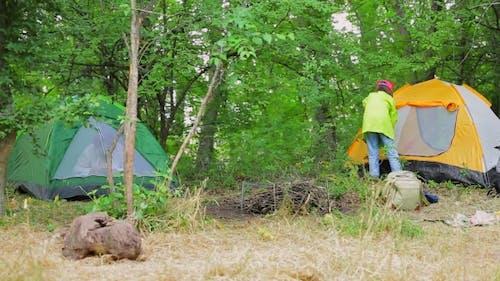 Tourist Girl Getting Inside Tent