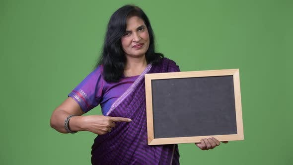 Thumbnail for Mature Beautiful Indian Woman Pointing To Blackboard