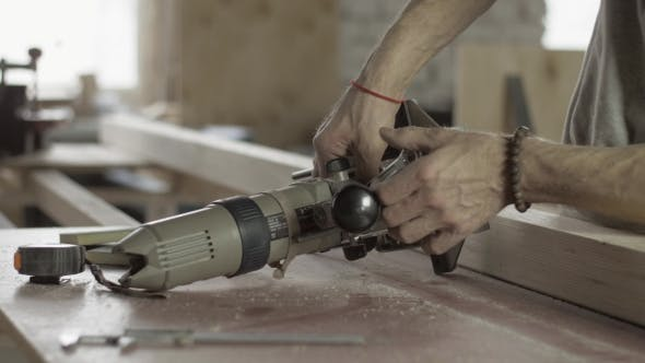 Thumbnail for Professional Carpenter Adjusts Plunge Router By Wrench. Furniture