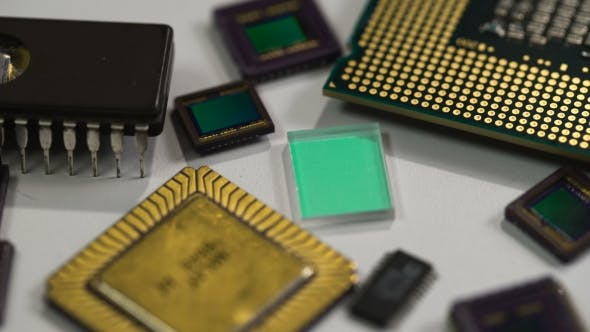 Cover Image for Computer Processor And Electronic Components On White Background