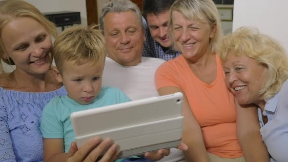 Thumbnail for Big Family Watching Video On Touch Pad