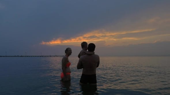 Thumbnail for Family With Child In The Sea At Twilight