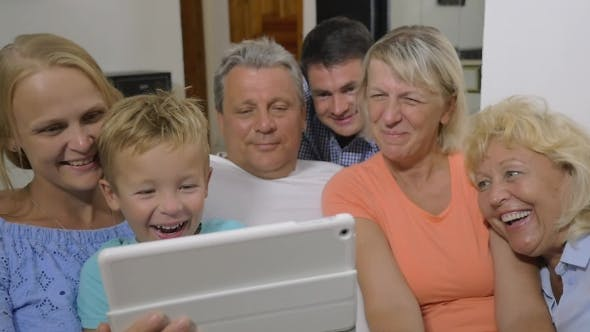 Thumbnail for Family With Child Watching Interesting Video On Pad