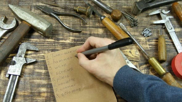 Thumbnail for Man's Hand List Out The Tools, Flat Lay