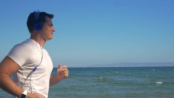 Thumbnail for Man Jogging With Music At The Seaside