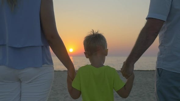 Thumbnail for Family With Child Looking At Sunset Over Sea