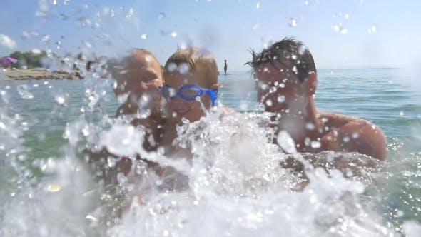 Exciting Sea Bathing Of Happy Family