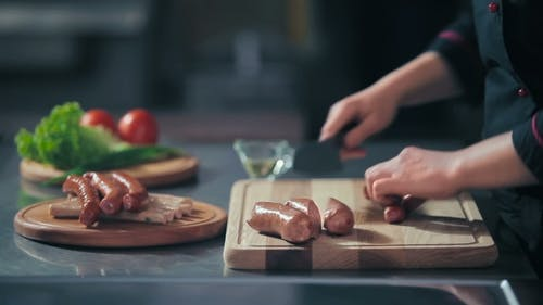 Cutting The Sausages On a Cutting Board
