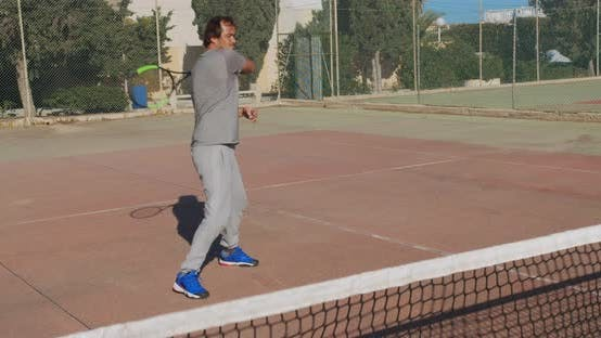 Thumbnail for Male Athlete Playing Tennis on Outdoors. The Ball Hits the Net, the Athlete Is Upset