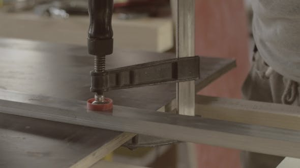 Professional Carpenter Fix Metal Balk On Wooden Board. Process Making Furniture