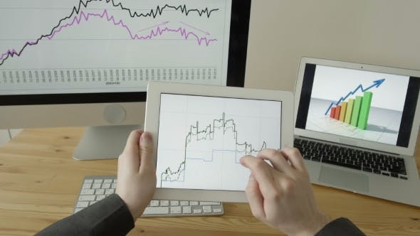 Thumbnail for Experienced Businessman Looking At Financial Data With Graphics