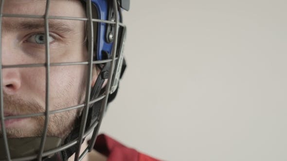 Thumbnail for Portrait Of a Hockey Player In Helmet Against White Backround