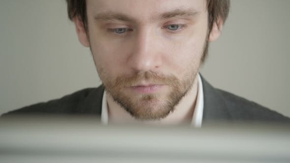 Thumbnail for Male Businessman Looking At Computer Screen In Office