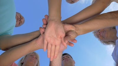 People With Hands Together
