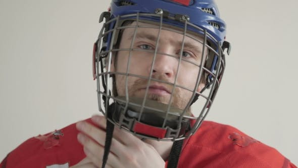 Cover Image for Young Ice Hockey Player Portrait Wearing Helmet On White Backgroud