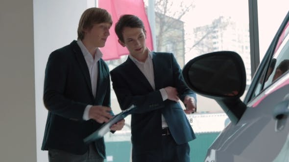 Thumbnail for Salesman Assisting Client In a Car Dealership