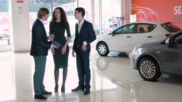 Thumbnail for Sales Manager Assisting Clients In Car Dealership