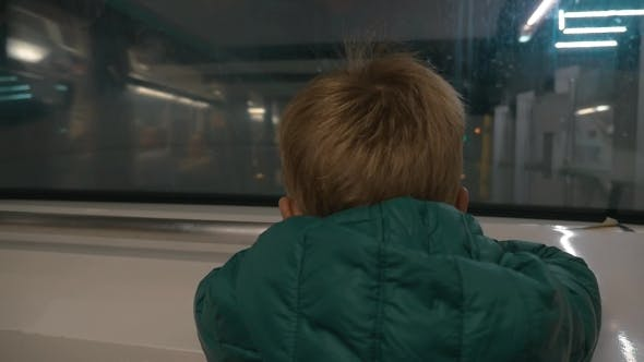 Thumbnail for Little Child Looking Out Subway Train Window